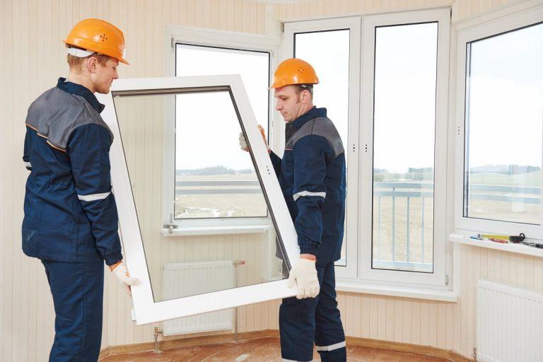 replacing windows - image of workers replacing windows