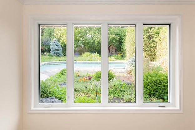 energy efficient windows - image of windows overlooking a backyard